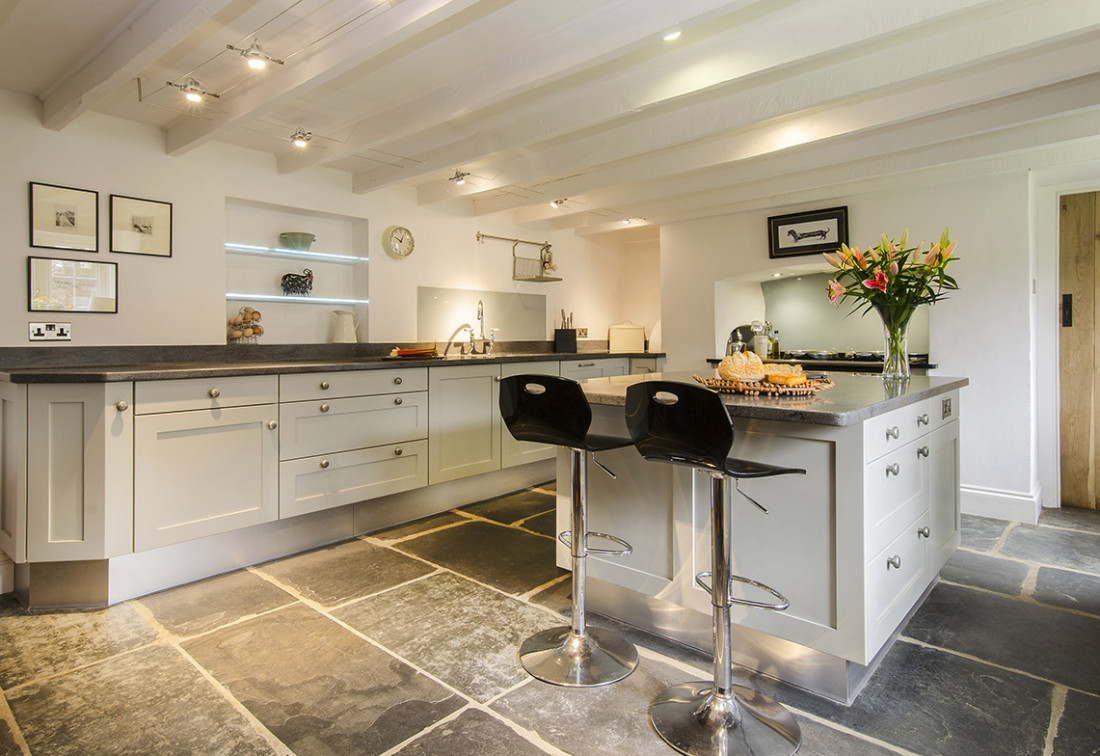 stunning modern cottage kitchen with flagstone floor