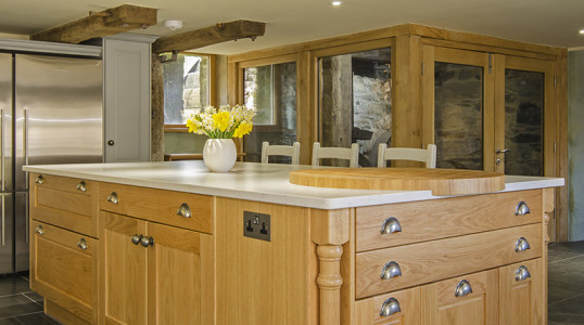 A wooden cottage kitchen with flagstone floors